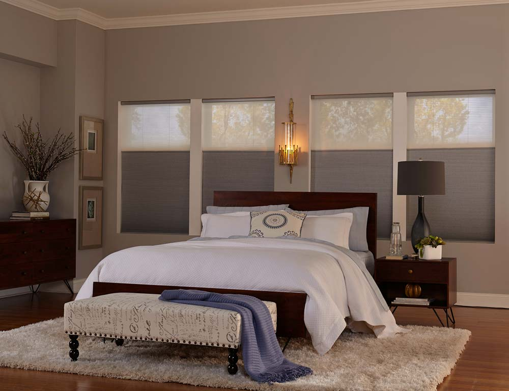 Serene bedroom with natural fabrics and textures and top down bottom up blinds